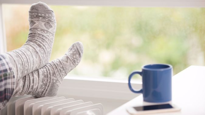 For larger rooms you want to heat regularly like a living room, it's worth paying a bit more upfront for a fixed heater with lower running costs and more heat output than an electric heater. (Photo \ Getty Images)