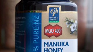 UK shop forced to put security cases on NZ honey