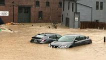Buildings collapse as torrential floods hit US city
