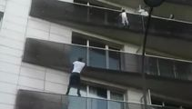 Man who climbed building to save boy rewarded with residency