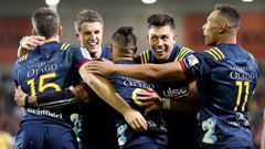 The Highlanders celebrate Aaron Smith's try against the Hurricanes. (Photo / Getty)
