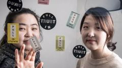 Organisers Tina Inah Kim, left, and Sarah Song Min Lee are organising Message of Hope stickers for suicide prevention. Photo / Michael Craig