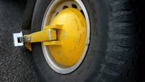 Minister takes aim at wheel clampers