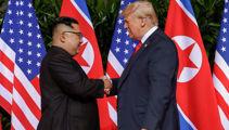 Trump and Kim make history with a handshake