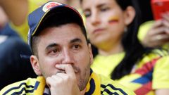 A Colombian fan reacts after his team's 2-1 loss to Japan. (Photo / AP)