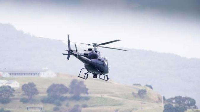 Under its eye: the police Eagle helicopter. New Zealand Herald Photograph by Greg Bowker