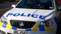 Auckland bank robbed by man with hidden weapon