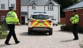 Police stand outside Dawn Sturgess and Charlie Rowley's home in Amesbury, England. (Photo / Getty)