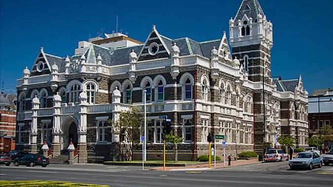Angela Marie Robertson pleaded guilty to two counts of assaulting police and one of wilful damage when she appeared in Dunedin District Court.