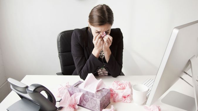 While Kiwis are more likely to take time off work when they are unwell than workers in other developed countries those who do. (Photo / Getty)