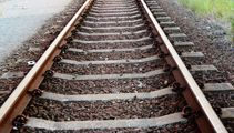 Elderly man dies after car goes onto train tracks