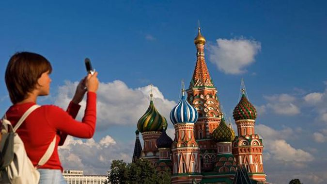 This tourist won't be able to share her photo on social media until she's out of Russia if the country's plans for the internet go ahead. Photo / Getty Images