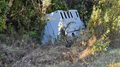 The van had two staff and five prisoners on board when it crashed off left State Highway 2. (Photo / NZ Herald)