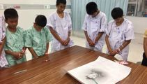 Rescued Thai boys pay respects to fallen diver