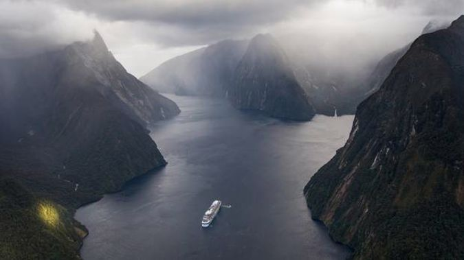 Megaliner Ovation of the Seas enters in Milford Sound in Fiordland. Photo / James Allan