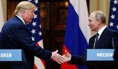 Donald Trump and Vladimir Putin shake hands. Photo / Getty Images