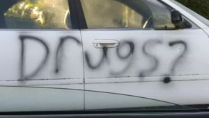 "A car on Brixton St had the word ""Drugs?"" spray painted over on Sunday. (Photo / Star.kiwi)"