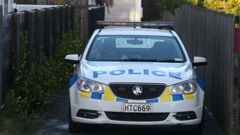 Police at the scene on Mount Maunganui home invasion. (Photo: John Borren)
