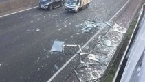 Shattered glass, powder causing delays on Auckland motorways