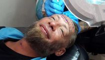 Inhuman stag party pays for homeless man's face tattoo