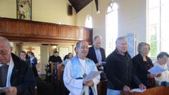 Reverend Chris Swannell enters his reception as Presider of the Holy Eucharist, Christ Church, Russell, on Sunday - the first New Zealander in an openly gay relationship to become an Anglican priest.