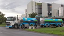 Fonterra cuts dividend for farmers and investors