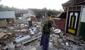 A man surveys his ruined house in North Lombok after the latest after shock. (Photo / AP)