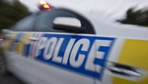 Person trapped between car and digger in central Auckland