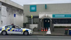 Police outside the Good Home Birkenhead this morning after it was robbed last night by armed men, the second time this year. (Photo / Supplied)