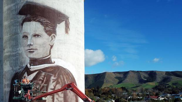 Waimate GP Margaret Cruickshank helped the sick in the 1918 influenza pandemic before herself dying of the disease. Artist Bill Scott has painted a mural of her on a grain silo in the town. (Photo / Supplied)