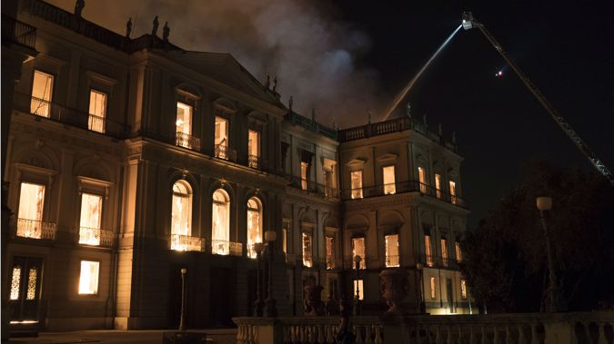 Firefighters worked to put out the blaze at the esteemed National Museum in northern Rio. Photo / Wikimedia