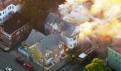 Firefighters battle a large structure fire in Lawrence. Photo / AP