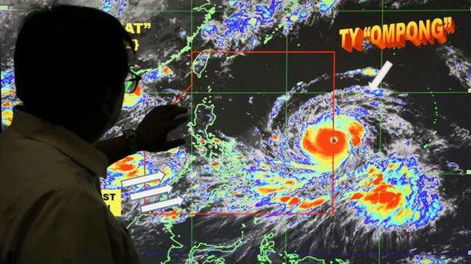 Filipino forecaster Meno Mendoza shows the path of Typhoon Mangkhut. Photo / AP