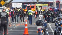 Police and other motorcyclists at the Reparoa crash scene. (Photo: Ben Fraser)