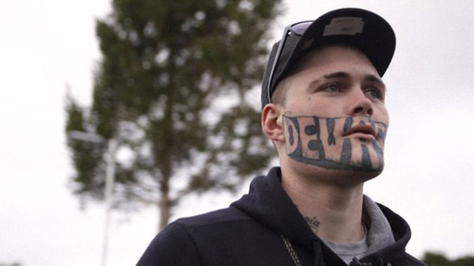 The man with the word Devast8 tattooed across his face is back before the courts. (photo/ NZ Herald)