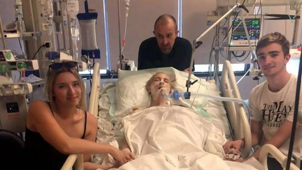 Abby Hartley - Mum to Sophie (left) and Toby (right) and wife to Richard Hartley (rear) in hospital in Bali. (Photo / Supplied)
