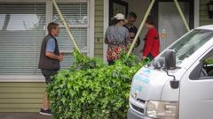Landlord Nina Zhao meets with the bailiff and a locksmith at her property in West Tamaki Rd after the illegal tenants were evicted. (Photo / Greg Bowker)