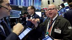 Stocks post slight gains at end of an ugly week on Wall Street