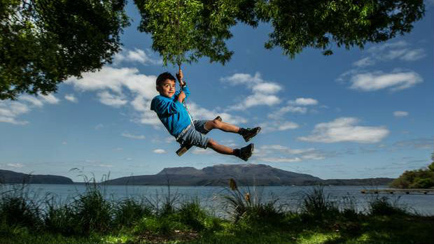 The sunny weather drew plenty of people outside around the country including Zac McIlroy, 5, at Lake Tarawera. Photo / NZME