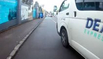 Watch: Van swerves into path of cyclist