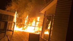 Fire nearly destroys home while family sleeps inside