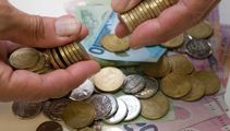NZ dollar eases on strong Aussie job growth