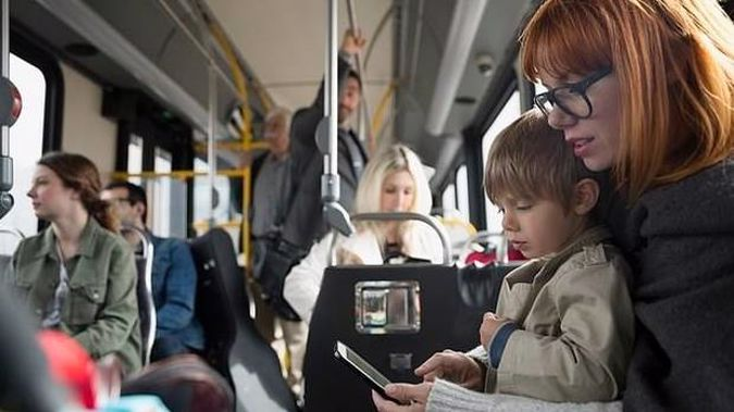 A woman has provoked a furious debate about children being made to give up their seats on public transport. Photo / Getty Images