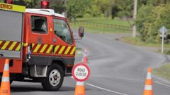 Emergency services at Henderson Valley Rd, in West Auckland, where a motorcyclist was killed. (Photo / Michael Craig)
