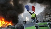 100,000 protesters descend on French streets in fuel tax protests