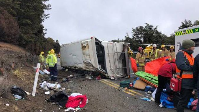 Emergency services worked to help the injured in the aftermath of a fatal bus crash near Tūroa skifield. Photo / Fenella Murphy