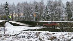 Powerful quakes buckle Alaska roads, tsunami no longer threat