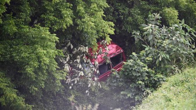 A car which has crashed off SH29 in the Kaimai Range. Photo / George Novak