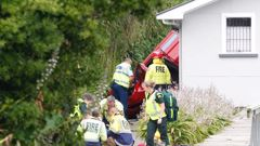 Emergency services attend to an accident on Somme Parade this afternoon. (Photo / Stuart Munro.)