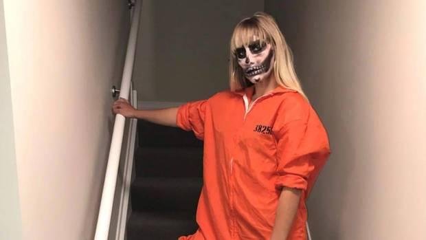 Rouxle Le Roux dressed up in an orange prison jumpsuit with the Instagram caption reading: 'Hide your children'